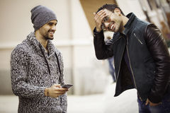 Two young men with a Smart phone Stock Photography
