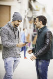 Two young men with a Smart phone Royalty Free Stock Photo