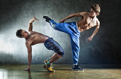 Two young men sports fighting. On wall background Royalty Free Stock Photos