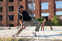 Two young men street dancing in a city square Stock Images
