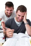 Two young men studying together Royalty Free Stock Photos