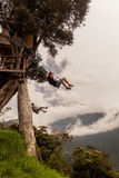 Two Young Men On A Swing In Banos De Agua Santa Stock Image