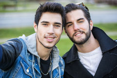 Two young men taking selfie Stock Images