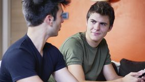 Two young men talking and chatting Royalty Free Stock Photo