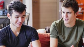 Two young men talking and chatting Stock Images