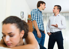 Two young men and unhappy girl Stock Image