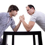 Two young men wrestling Stock Photos