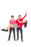 Two young men and a young girl dressed in red Stock Images