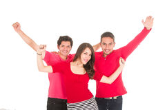 Two young men and a young girl dressed in red Royalty Free Stock Photography