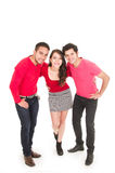 Two young men and a young girl dressed in red Royalty Free Stock Images
