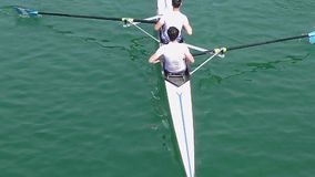 Two young mens on rowing, slow motion video stock footage