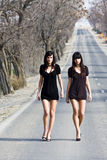 Two young models. Two couple of young models parading in the middle of the road stock image