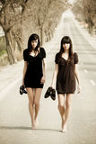 Two young models. Two couple of young models parading in the middle of the road stock photography