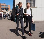 MILAN - SEPTEMBER 21: Two young models walking after LES COPAINS fashion show, during Milan Fashion Week spring/summer 2018 stock photo