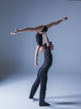 Two young modern ballet dancers on blue studio Stock Images