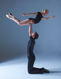 Two young modern ballet dancers on blue studio Royalty Free Stock Photos