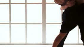 Two young modern ballet dancers dancing indoor. Athletic ballet man with naked torso dancing with his female partner in dance studio. Passion and sensuality stock video footage