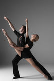 Two young modern ballet dancers on gray studio Stock Photo