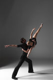 Two young modern ballet dancers on gray studio Stock Photography