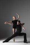 Two young modern ballet dancers on gray studio Stock Photos