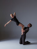Two young modern ballet dancers on gray studio Stock Images