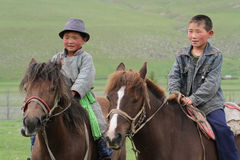 Two young mongolian riders Stock Photography
