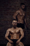 Two young muscular men Royalty Free Stock Photos