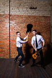 Two young musicians having fun with guitar Stock Photos