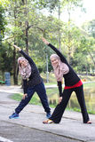 Two young muslim women is stretching Royalty Free Stock Photo