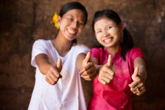 Two young Myanmar girls giving thumb up Royalty Free Stock Photo