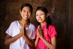 Two young Myanmar girls in welcoming posture Royalty Free Stock Image
