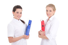 Two young nurses with folders Royalty Free Stock Photo
