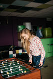 Two Young Office People Enjoying Table Soccer Game During their Free Time at the Workplace Royalty Free Stock Image