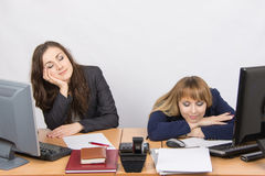 Two young office worker sleeping on the job Royalty Free Stock Photography