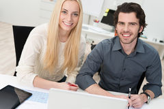 Two young office workers Royalty Free Stock Images