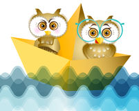 Two young owls at the sea Stock Photography