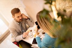 Businesspeople In A Cafe stock images