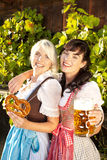 Two young people with beer glasses and bretzel Stock Image