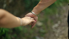 Two Young People Boy and Girl are Holding Hands stock video footage