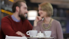 Two young people in cafe enjoying the time stock footage
