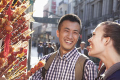 Two young people with candied haw. Stock Photo