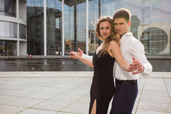 Two young people dancing tango outside on city embankment Royalty Free Stock Image