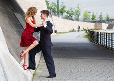 Two young people dancing tango somewhere in the city Royalty Free Stock Photo