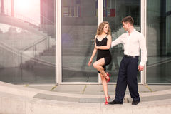 Two young people dancing tango somewhere in the city Royalty Free Stock Photos