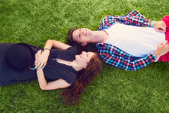 Two young people enjoying on the grass Stock Images