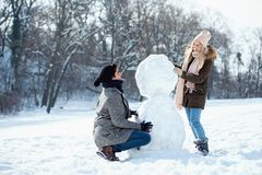 Two young people enjoying in the snow stock photo
