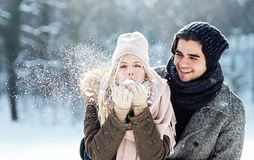 Two young people enjoying in the snow stock images