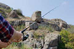 A young couple came on a fishing trip to catch fish for dinner. Fishing together on a beautiful background. Stock Photography