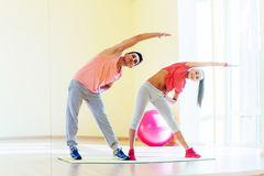 Two young people in the gym doing exercises for fitness Royalty Free Stock Images