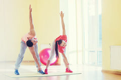 Two young people in the gym doing exercises for fitness Stock Photography